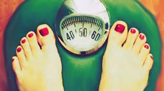 person weighing themselves